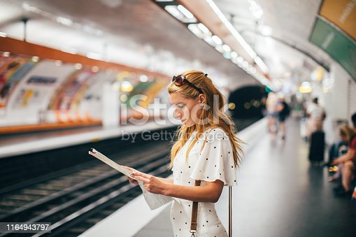 Young tourist woman in Paris metro station