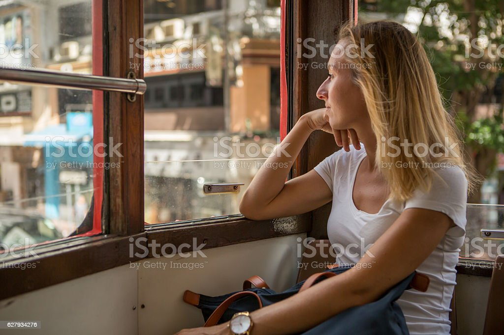 Young tourist woman on double decker cable car-Hong Kong stock photo