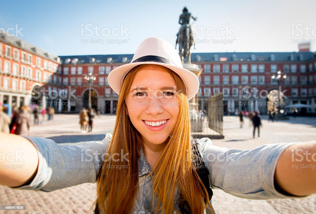 young tourist woman visiting Europe in holidays taking selfie picture stock photo