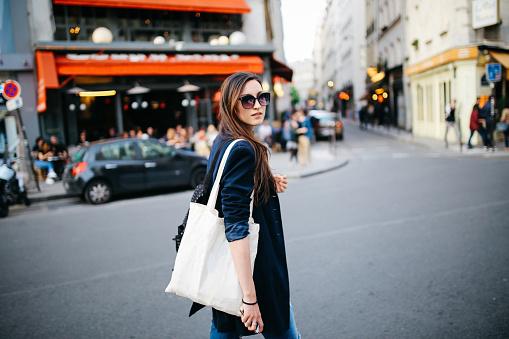 Young tourist woman walking in Paris
