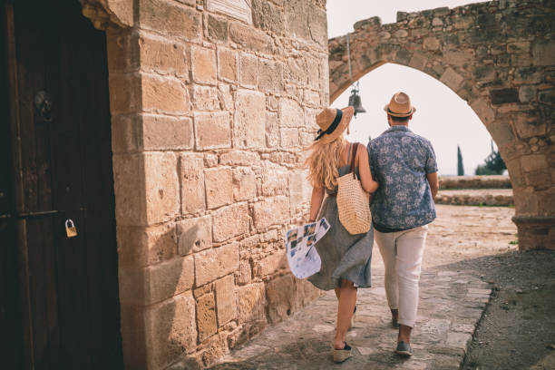 Young tourists couple doing sightseeing at stonebuilt monument in Europe stock photo