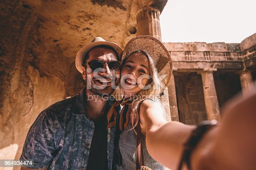 istock Young tourists couple taking selfies at ancient monument in Italy 964934474