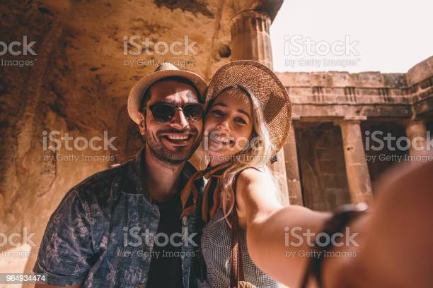 Young tourists couple taking selfies at ancient monument in italy picture id964934474?b=1&k=6&m=964934474&s=612x612&h=7mdelvdizokxn5qgwx g6zd puzwbgjwa6kedgbocv0=