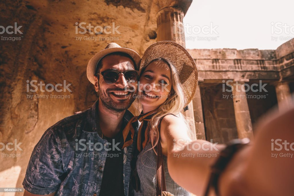 Young tourists couple taking selfies at ancient monument in Italy stock photo