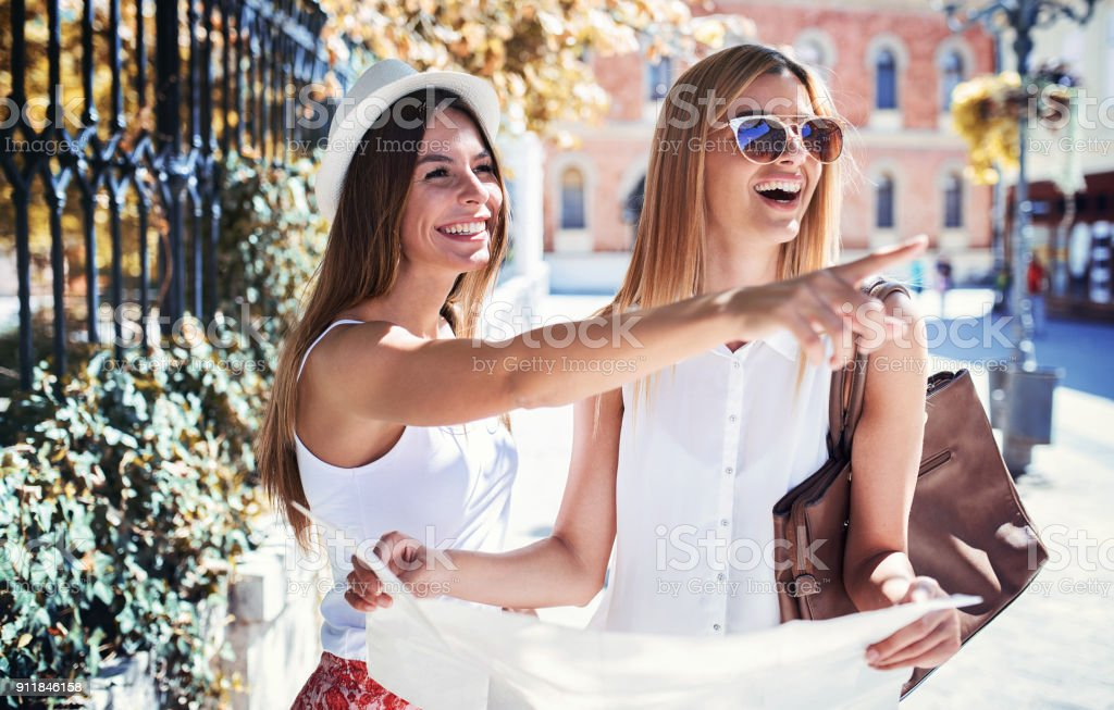 Young tourists enjoying in vacation, having fun together. Concept of tourism stock photo