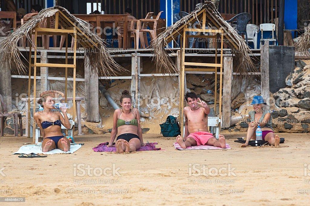 Young tourists enjoying on sandy Hikkaduwa beach stock photo