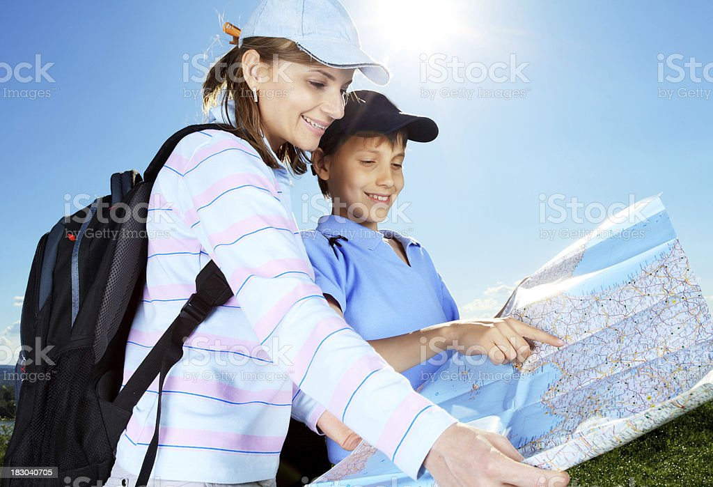Young tourists looking at the map. royalty-free stock photo