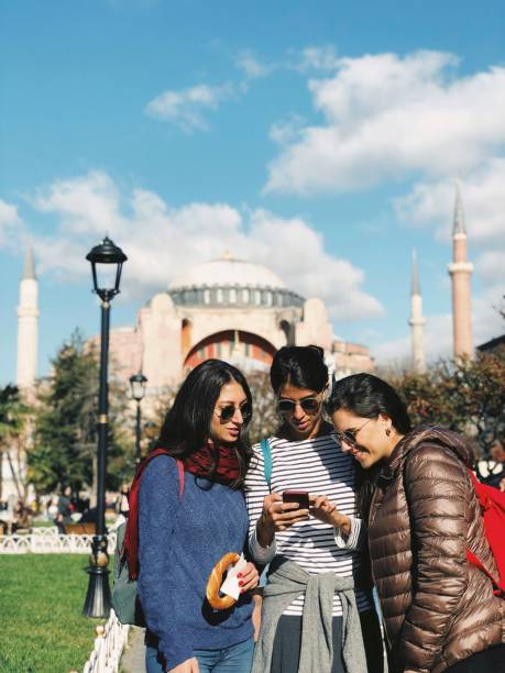 Young tourists searching for a place in Istanbul stock photo
