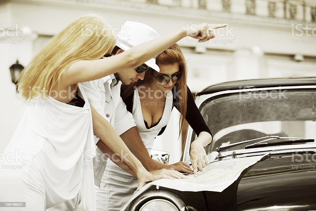 Young tourists with a road map. royalty-free stock photo