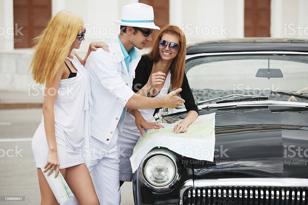 Young tourists with a road map royalty-free stock photo