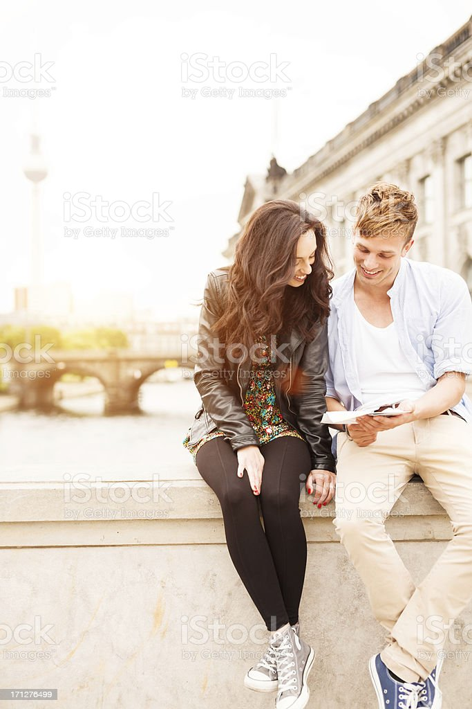 young tourists with map royalty-free stock photo