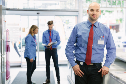 istock Young trainee in retail store 186546024
