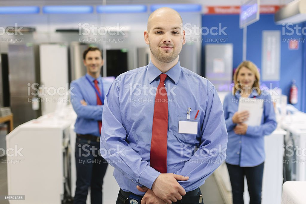 Young trainee in retail store royalty-free stock photo