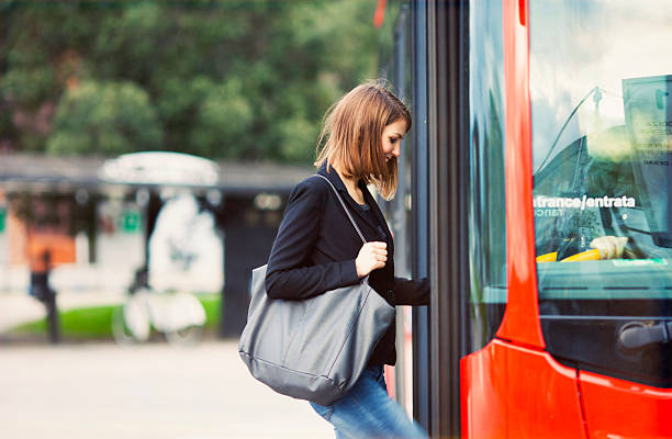 young traveler boarding a bus - getting on stock photos and pictures