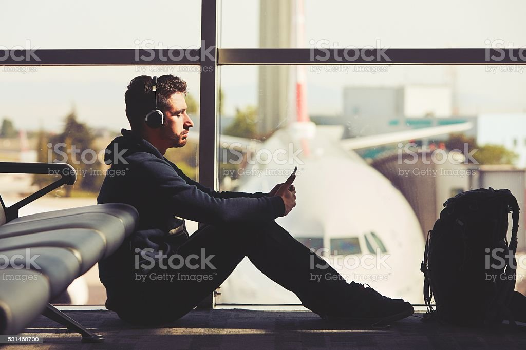 Young traveler Young traveler is waiting at the airport Adult Stock Photo