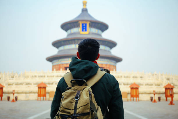 Young traveler standing in front of temple of heaven - in Beijing, China. Asia Travel stock photo
