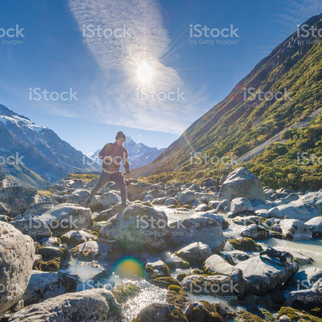 Young traveler taking photo at mt cook famaus destination in new zealand stock photo