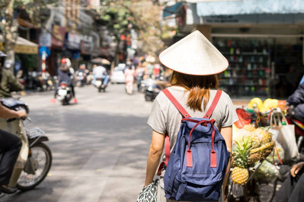 Young traveler with backpack at old quarter in Hanoi Young traveler with backpack at old quarter in Hanoi, Vietnam hanoi stock pictures, royalty-free photos & images