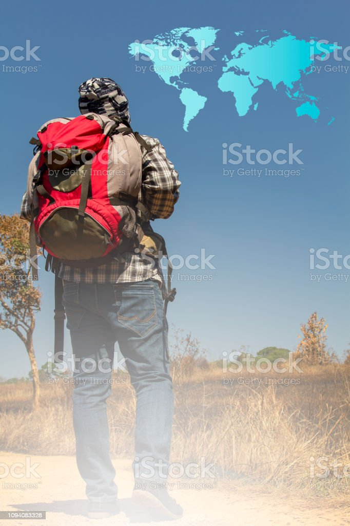 Young traveler with his backpack traveling around the world. stock photo