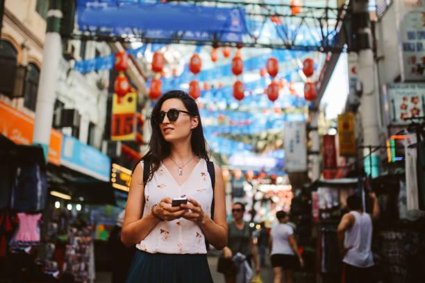 Young traveler woman walking in Kuala Lumpur Chinatown district stock photo