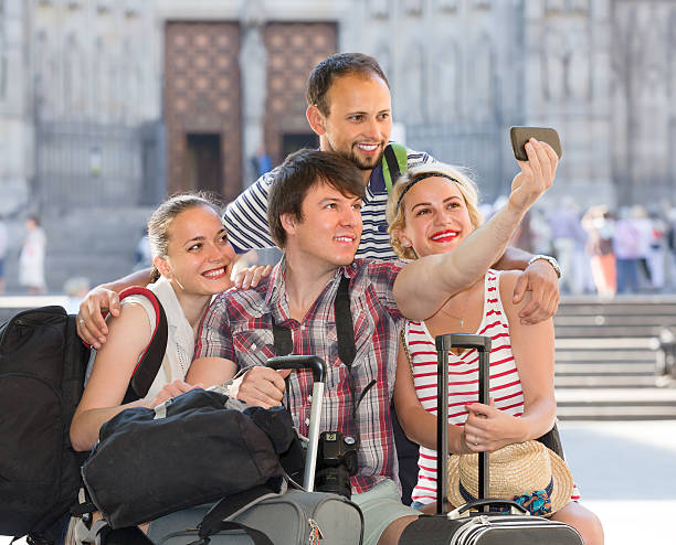 Young travelers doing selfie stock photo