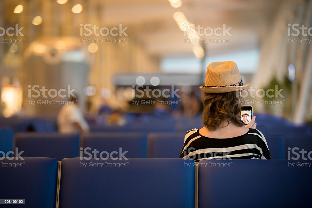 Young traveling woman waiting for transport stock photo