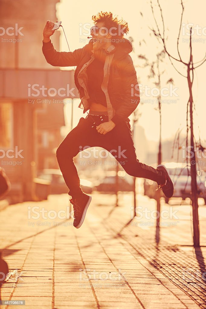young trendy man taking selfie stock photo
