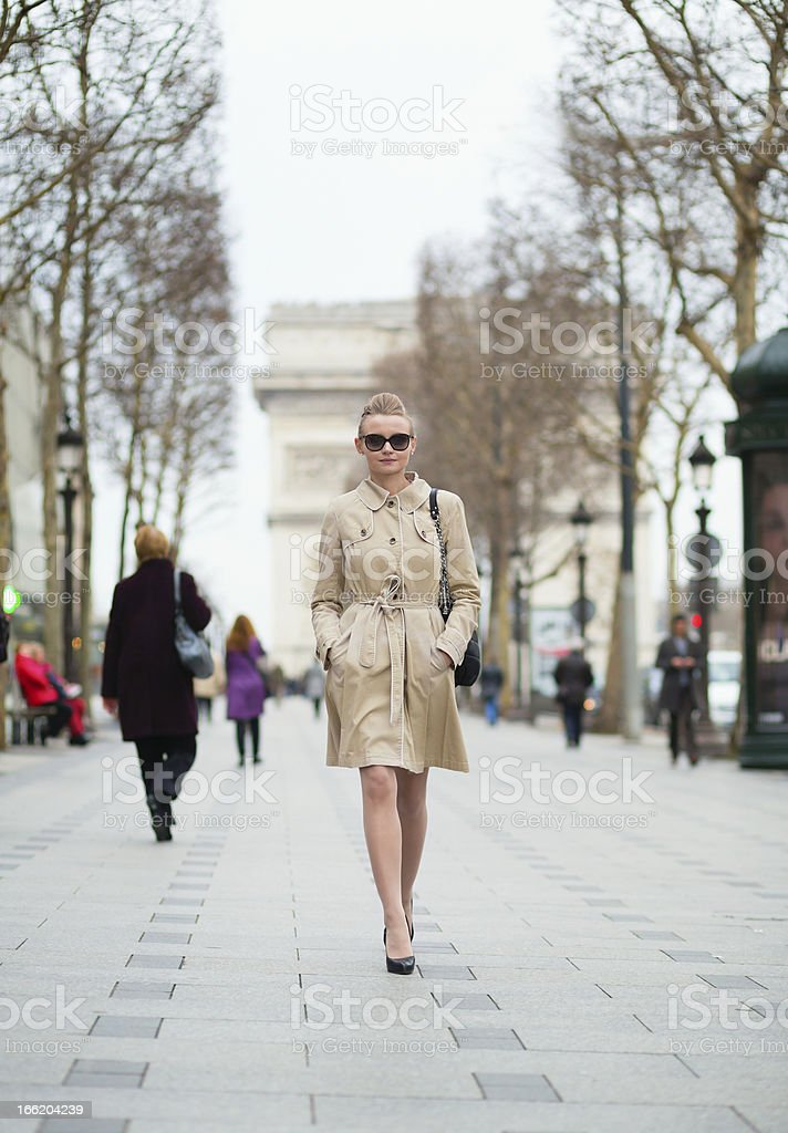Young trendy Parisian woman in the street stock photo