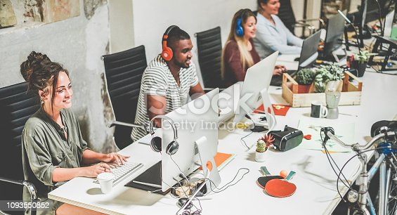 istock Young trendy teamwork using computer in creative coworking office - Business people working together at new app project - Focus on left woman face - Technology, influencer, marketing and job concept 1093550852