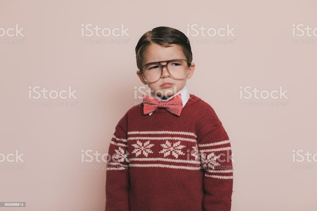 Young Ugly Christmas Sweater Boy is Sad stock photo