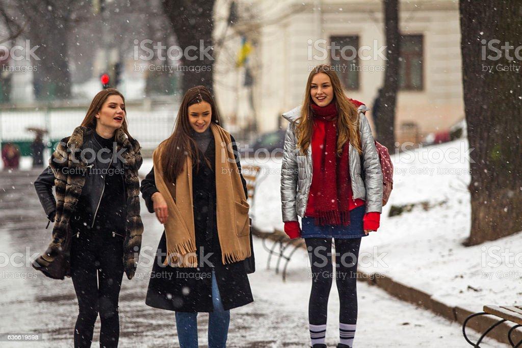 Young ukranian girl model friends walking at park  lviv ukraine stock photo