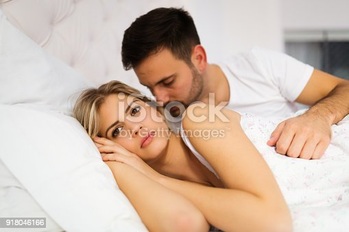 istock Young unhappy couple having problems in relationship 918046166