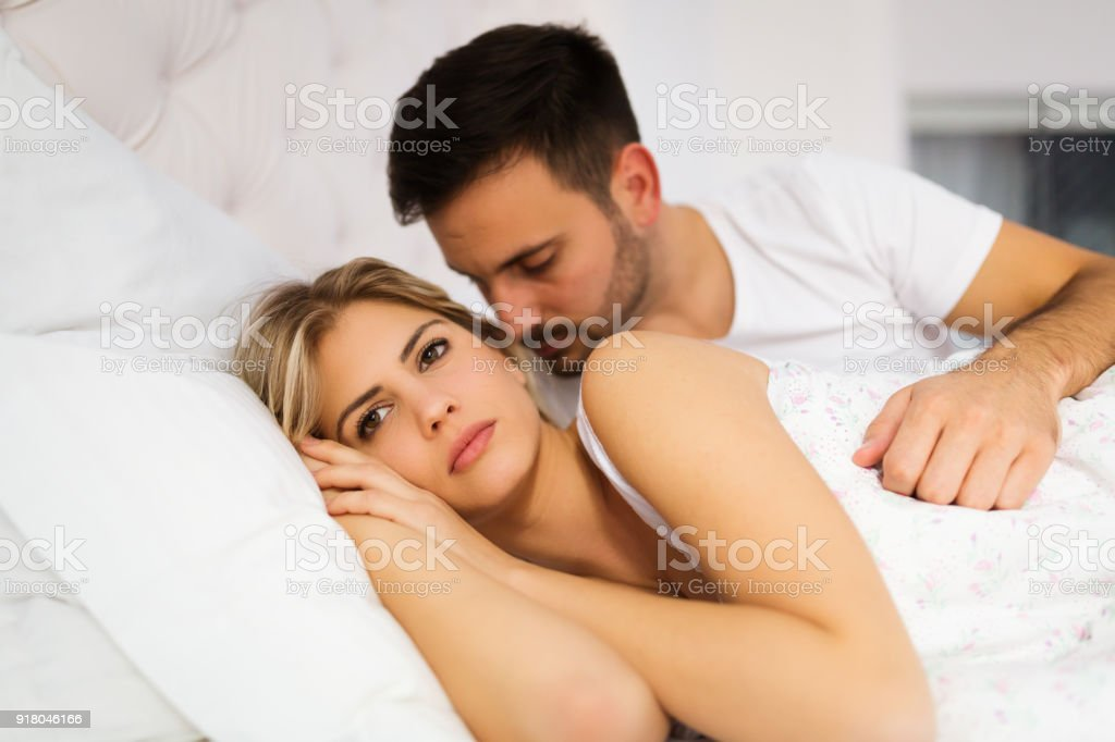 Young unhappy couple having problems in relationship stock photo