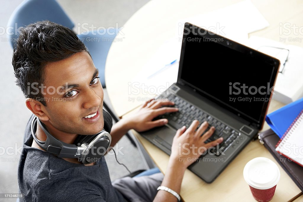 Young university student researching information royalty-free stock photo