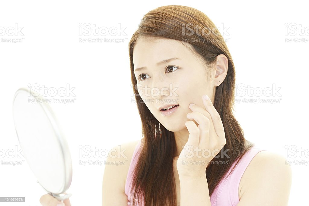 Young upset woman has problems with her skin stock photo