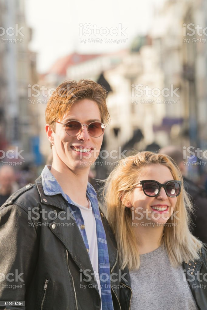 Young urban couple posing on the street. stock photo