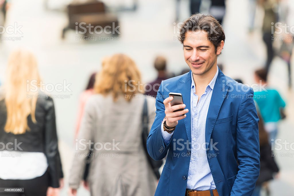 Young urban entrepreneur texting stock photo