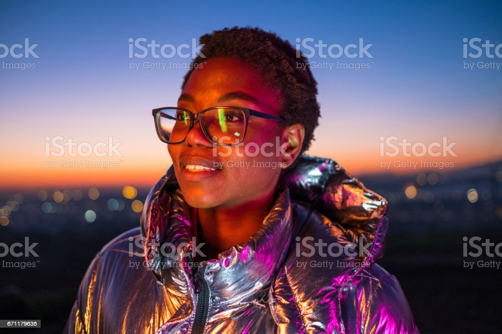 Young urban girl and city lights stock photo