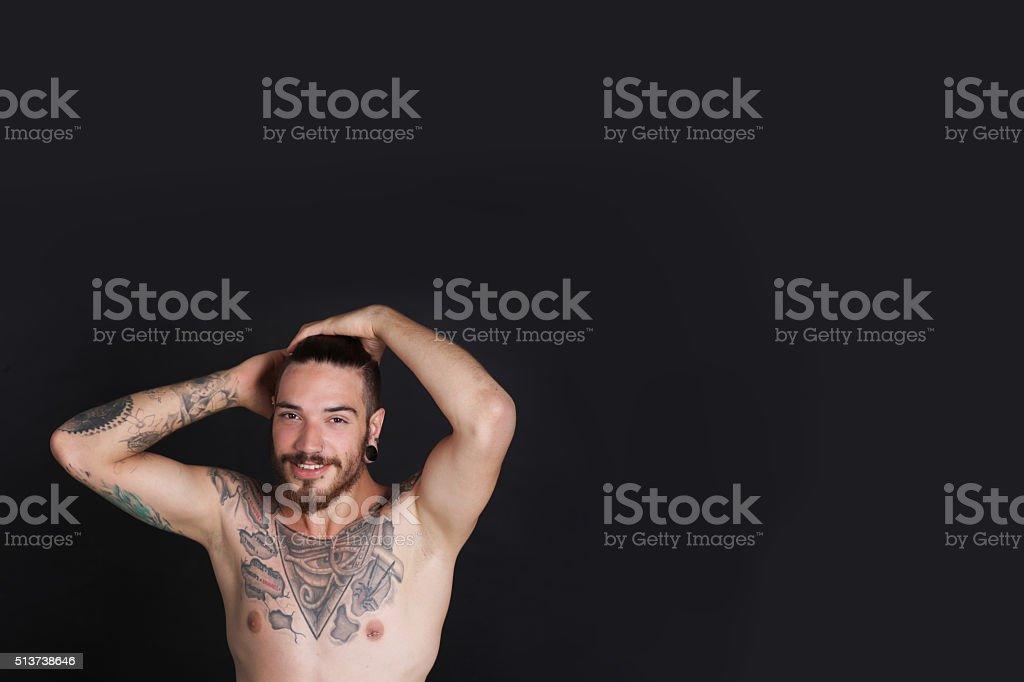 Foto De Jovem Urbana De Homem Com Tatuagens Ganso Da Cintura