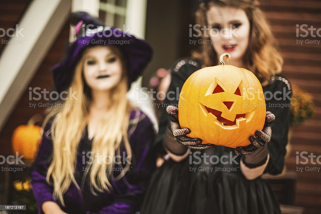 Young vampire and witch dressed up for halloween royalty-free stock photo