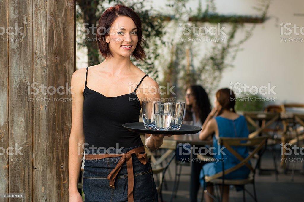 Young vibrant cheerful working waitress portrait modern trendy restaurant stock photo