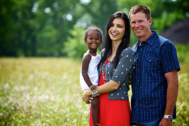 young vibrant ethnic diverse family stock photo