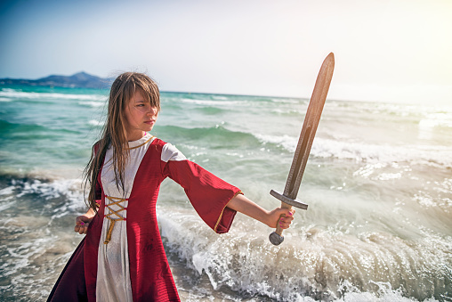 istock Young viking shieldmaiden practicing with sword 635845098