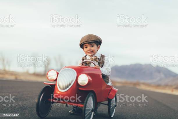 Young vintage boy drives toy car picture id899687492?b=1&k=6&m=899687492&s=612x612&h=jnj 3 cfhr5q3imnqplndnjvdea23sxaxlxklcjo6f0=