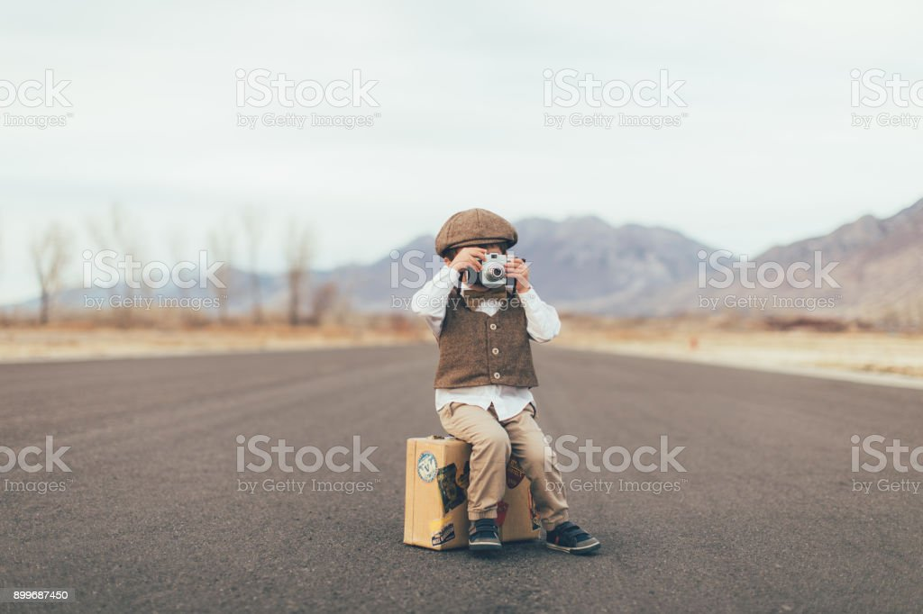 Young Vintage Boy Photographer with Camera stock photo