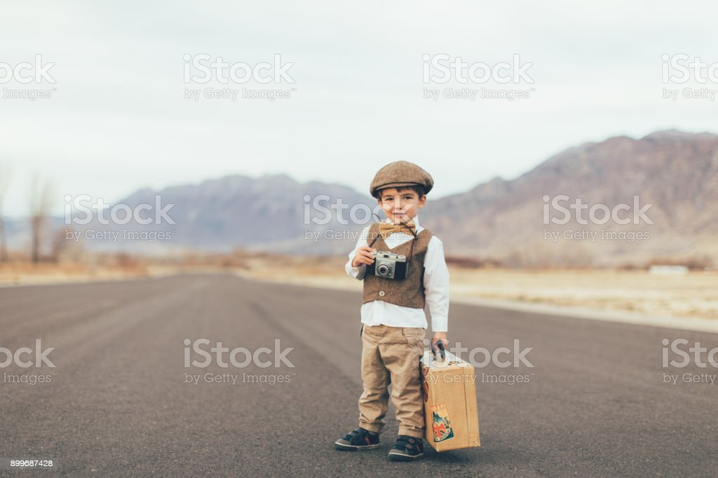 Young Vintage Traveling Boy with Camera stock photo