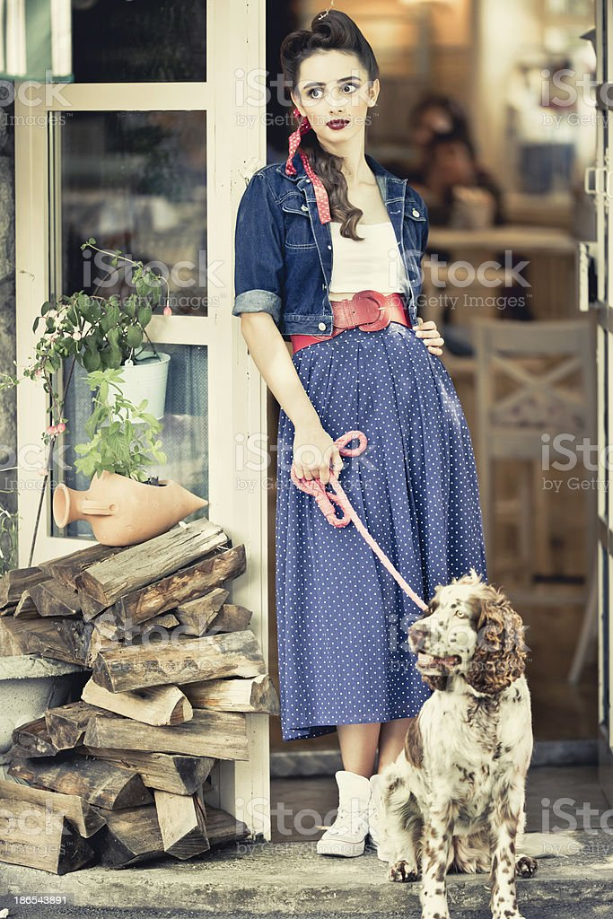 Young vintage woman with her dog stock photo