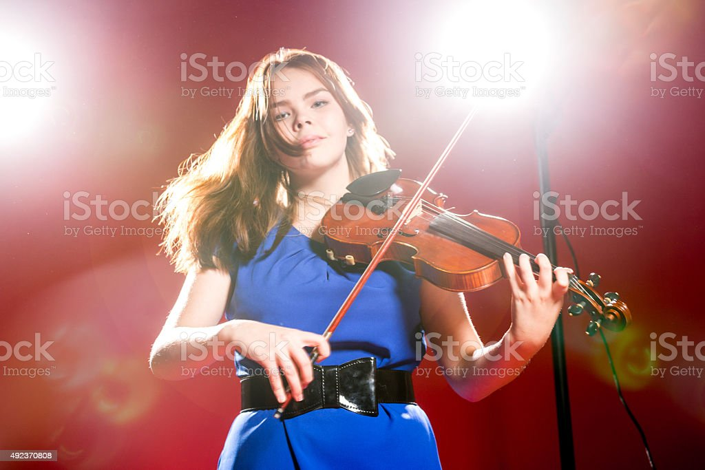 Young Violinist In The Spotlight stock photo