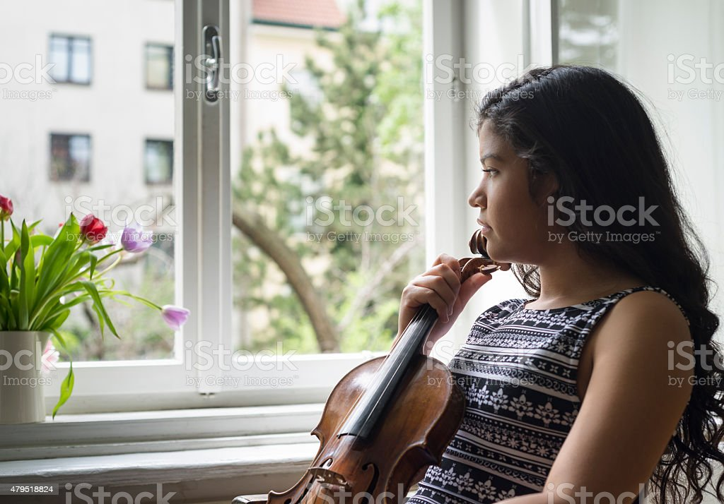Young violinist woman stock photo