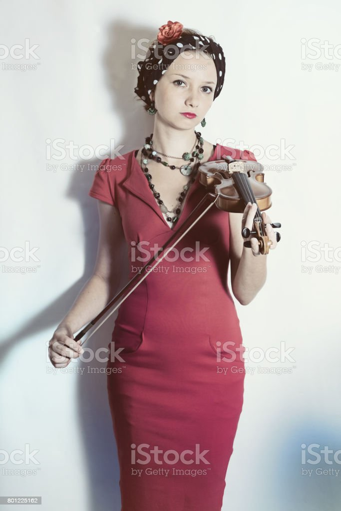 Young violinist woman with violin in hands stock photo
